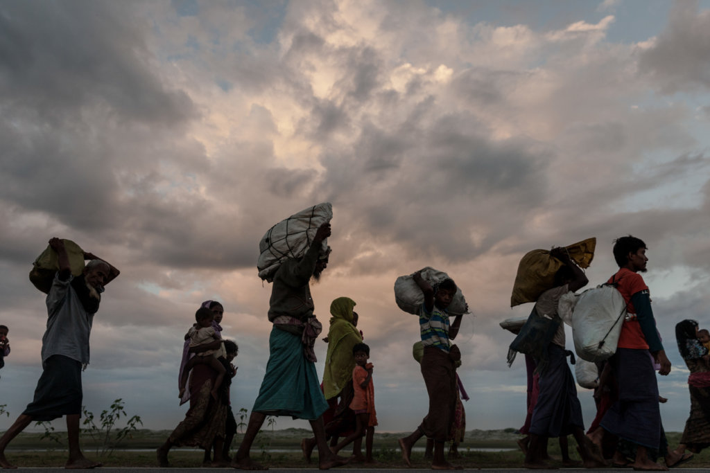 Newly arrived Rohingya refugees walk to the nearest refugee reception point in the coastal village of Shamlapur in Cox's Bazar District, Bangladesh. Myanmar Army-led attacks forced more than 700,000 Rohingya to flee to Bangladesh beginning in August 2017. Patrick Brown © Panos/UNICEF 2018