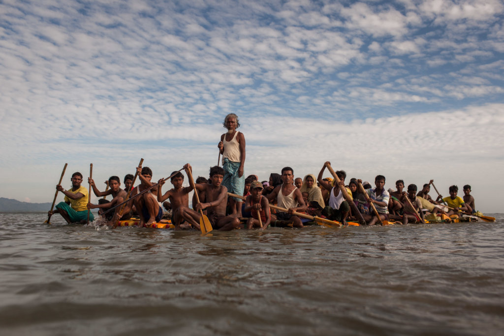 Stranded on the Myanmar border with limited or no food and water for up to 20 days after fleeing Myanmar Army-led attacks, Rohingya refugees finally cross the Naf River on a makeshift raft made of bamboo and empty palm-oil cans—a five to seven-hour-long journey. Patrick Brown © Panos/UNICEF 2018