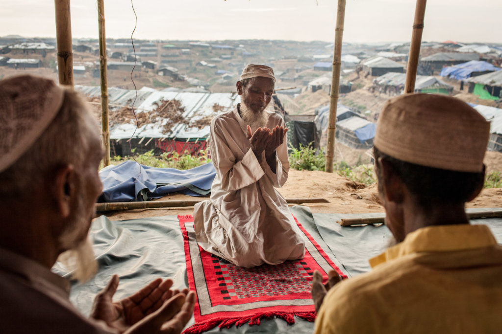 Imam Nurul, 53, during afternoon prayers at a makeshift mosque in Kutupalong refugee camp, Cox's Bazar District, Bangladesh. Patrick Brown © Panos/UNICEF 2018