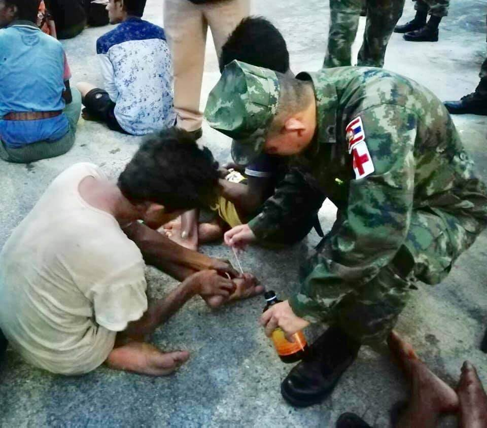 Thai official providing medical treatment to a Rohingya refugee who recently arrived to Thailand by boat. ©Wassana Nanuam, 2019