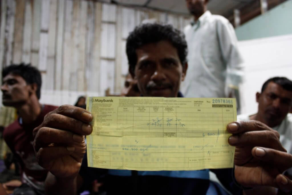 A Rohingya trafficking survivor in Malaysia shows a receipt for money paid to a human-trafficking syndicate for the release of a family member. ©Fortify Rights, Johor State, Malaysia, 2015