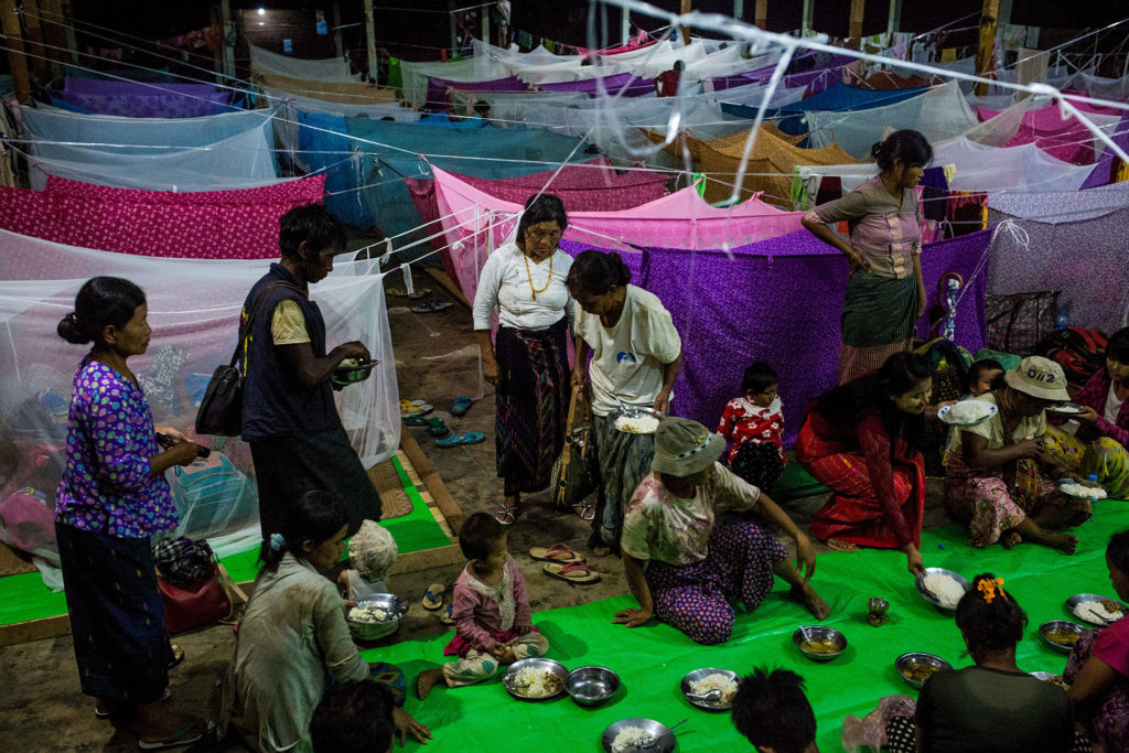 Displaced Kachin sharing a meal at Tanai Kachin Baptist Church in Tanai Township, Kachin State. The Myanmar military's restrictions on humanitarian aid organizations have driven food shortages among displaced communities in Kachin State. ©Hkun Lat, June 2017.