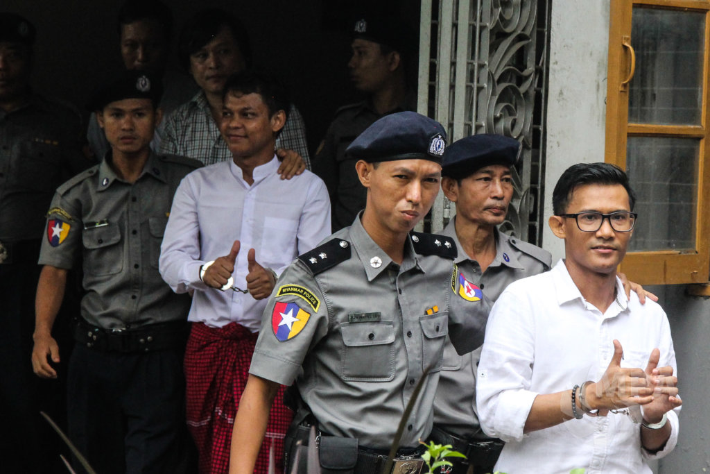 Police take Eleven Media journalists Phyo Wai Win, Nayi Min, and Kyaw Zaw Linn to Insein Prison after their court appearance in Yangon, October 10. ©Mar Naw / MPA 2018