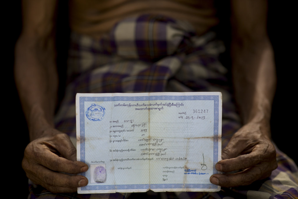 "N.M., 75, shows his original White Card receipt. The Myanmar government issued the receipts to Rohingya after revoking their White Cards in March 2015. The government began issuing the White Cards, also known as ""Temporary Registration Cards"" to Rohingya in 1995. Neither  the White Card nor the receipt confer any rights to Rohingya. ©Saiful Huq Omi, Counter Foto, Cox's Bazar District, Bangladesh, August 2019"