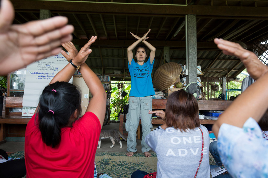Environmental defender Pornthip Hongchai preparing residents for a peaceful protest in Loei Province. ©Luke Duggleby/Fortify Rights, 2016