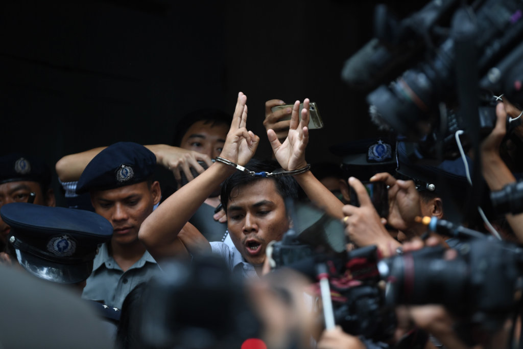 Kyaw Soe Oo escorted by police officers out of Yangon court. ©Mar Naw, 2018