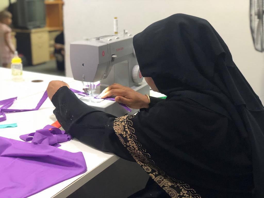 Rohingya refugee woman sews clothing through an RWDN livelihood program, Kuala Lumpur, Malaysia. ©RWDN 2019