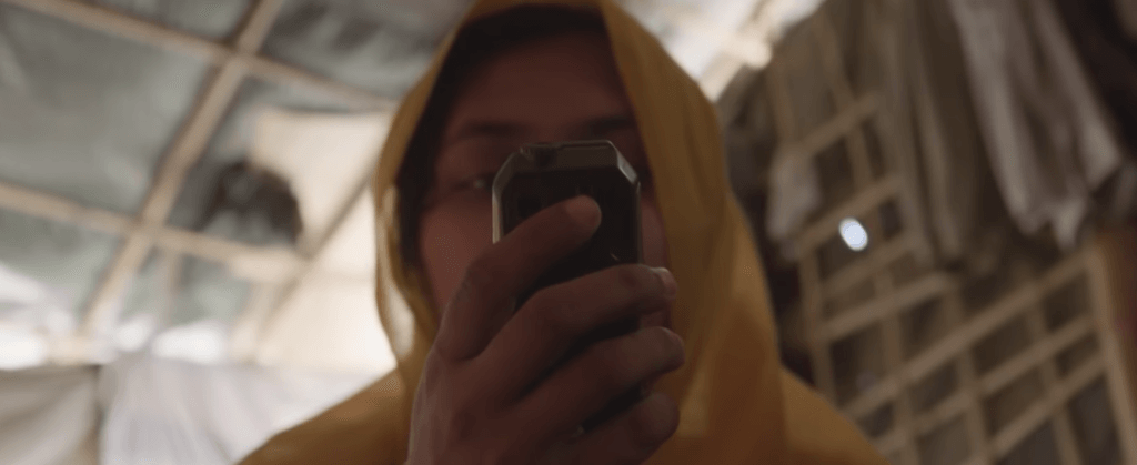 A Rohingya refugee uses a mobile phone in Cox's Bazar District, Bangladesh. ©Fortify Rights, 2018