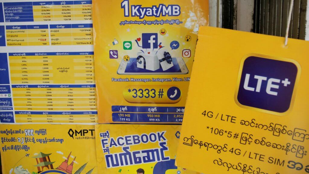 Signs at a cellphone shop in Yangon, Myanmar, pictured in August 2018: Facebook comes preloaded on new mobile phones. ©Reuters