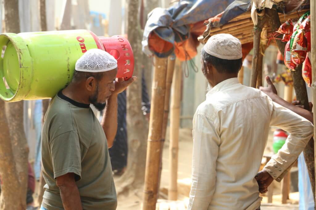 A Rohingya man carries a gas tank after going to a distribution point in the refugee camps in Cox's Bazar District, Bangladesh.©Fortify Rights, 2020