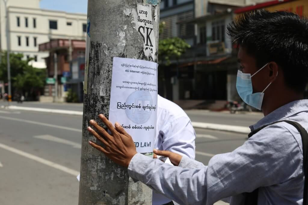 Two students from ABFSU post anti-war posters on September 15 at the corner of 73rd and 37th Street in Mandalay.©Kaung Zaw Hein, 2020